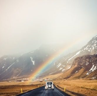 Balanced driving car under a rainbow